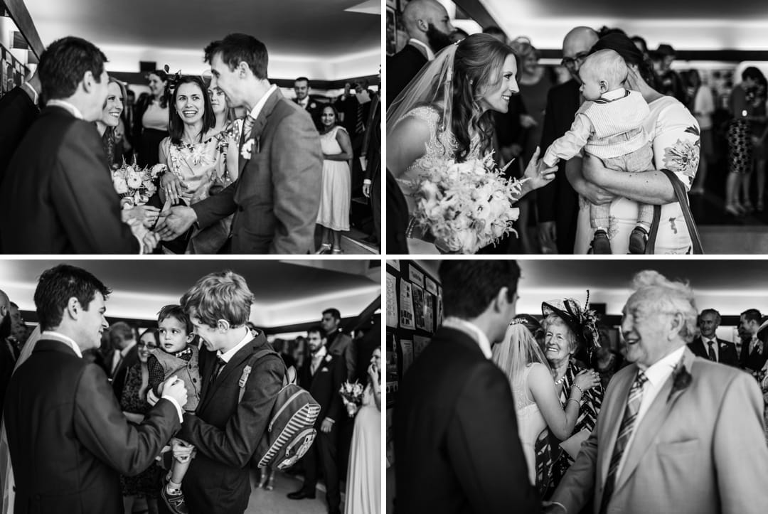 wedding guests congratualte bride and groom