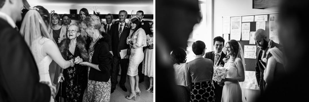 wedding guests congratualte bride and groom in South Wales