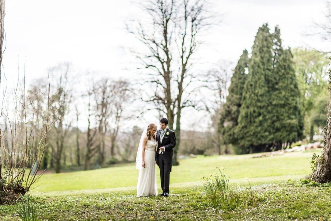 bride and groom in gardens at coed y mwstwr