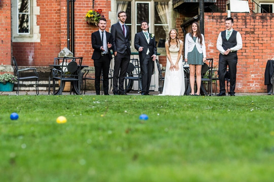 wedding guests playing bowls