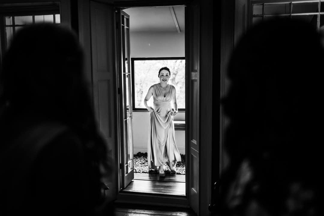 bridesmaid in door frame