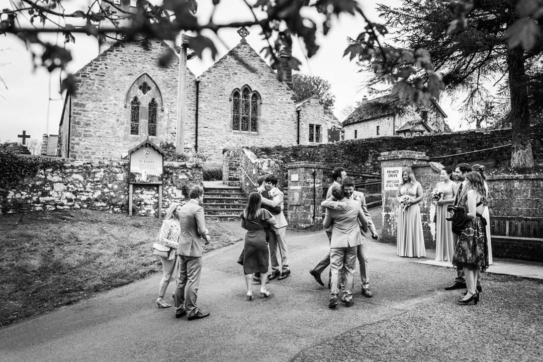 Guests arrivng for wedding at St James' Church, Manorbier