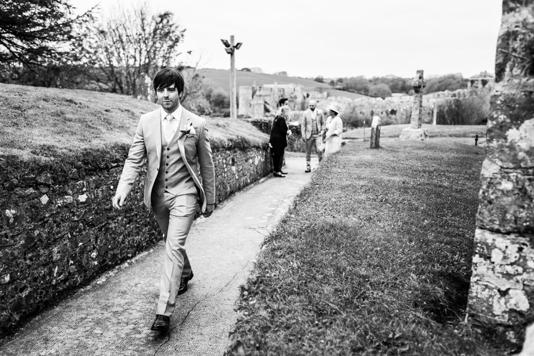 groom walks on church path