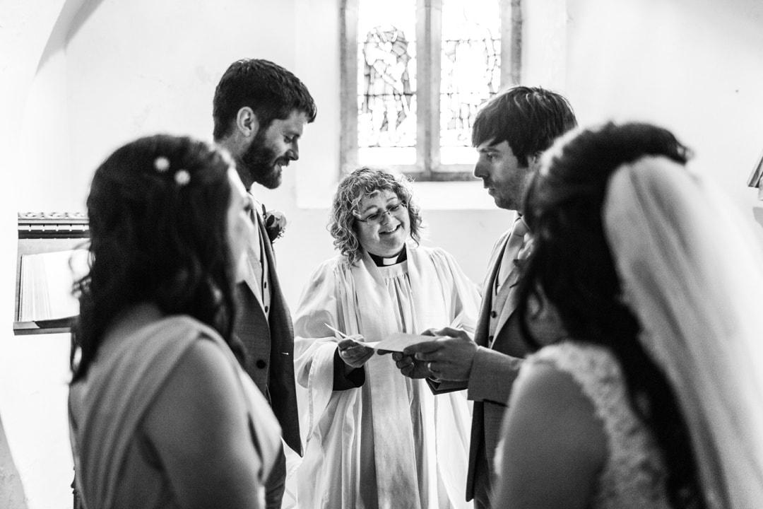 vicar hands wedding certficate