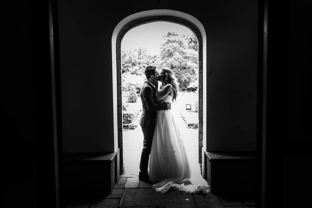Bride and groom in doorway of Bryngarw House