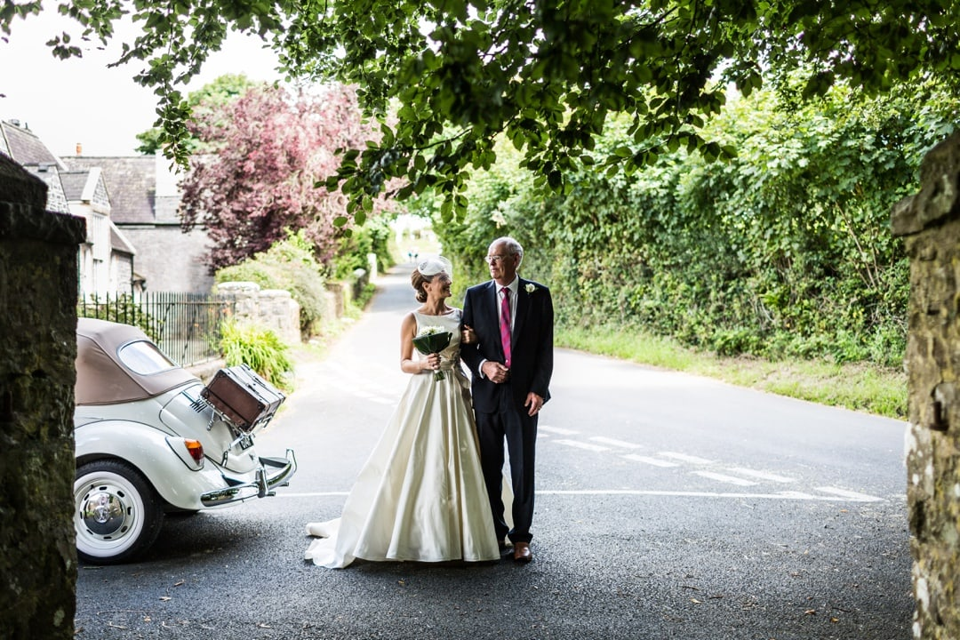 Bride arriving at St Elidyr's Church wedding in Pembrokeshire