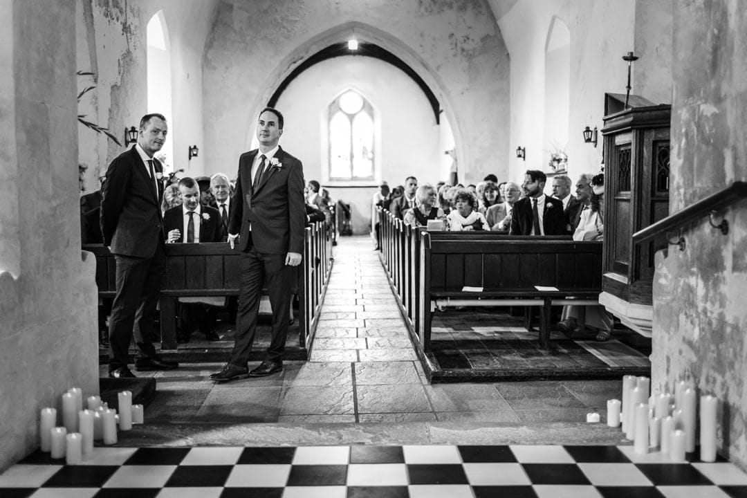 Groom waiting at St Elidyr's Church wedding in Pembrokeshire