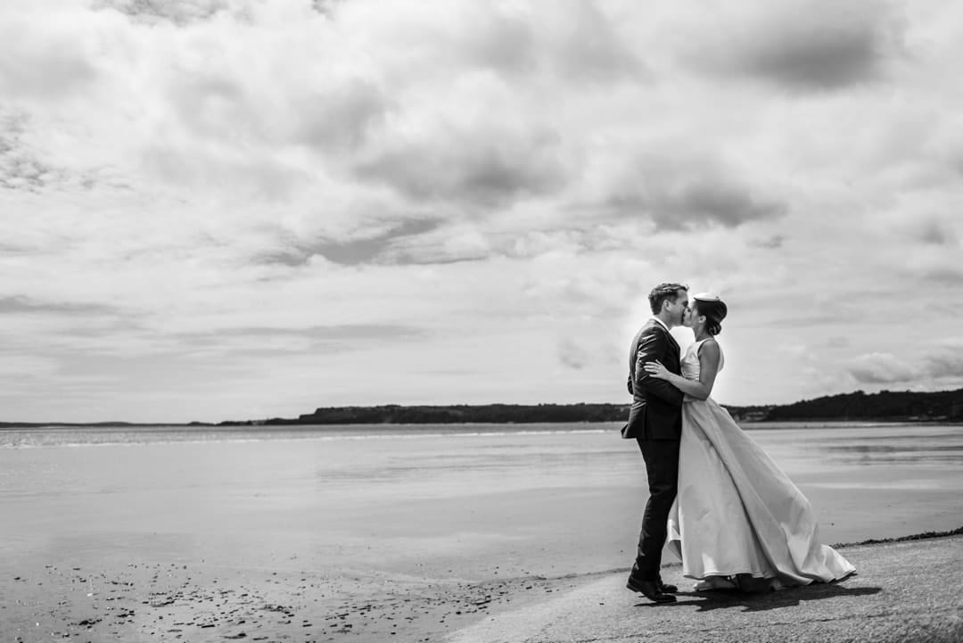 wedding couple on Amroth beach in Pembrokeshire