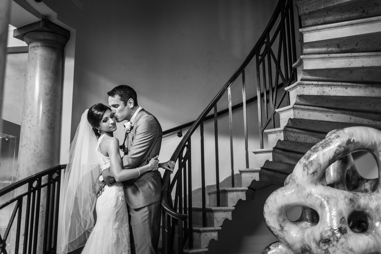 Bride and groom on spiral staircase at Cardiff museum