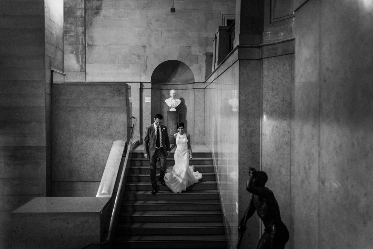 bride and groom on stairs at Cardiff Museum