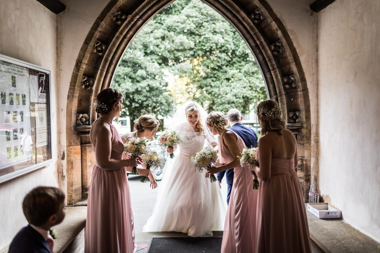 brides arrive in church doory