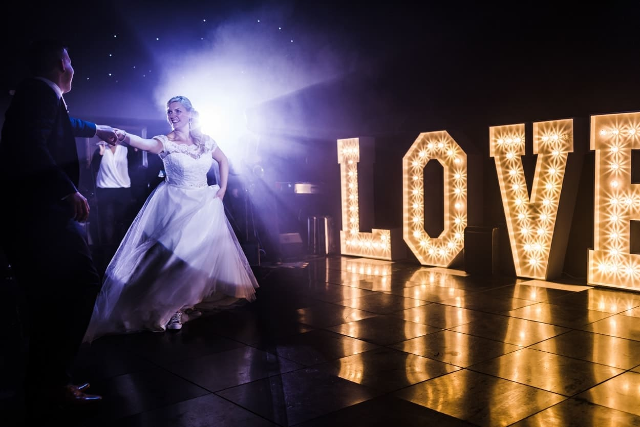 first dance in front of LOVE lights