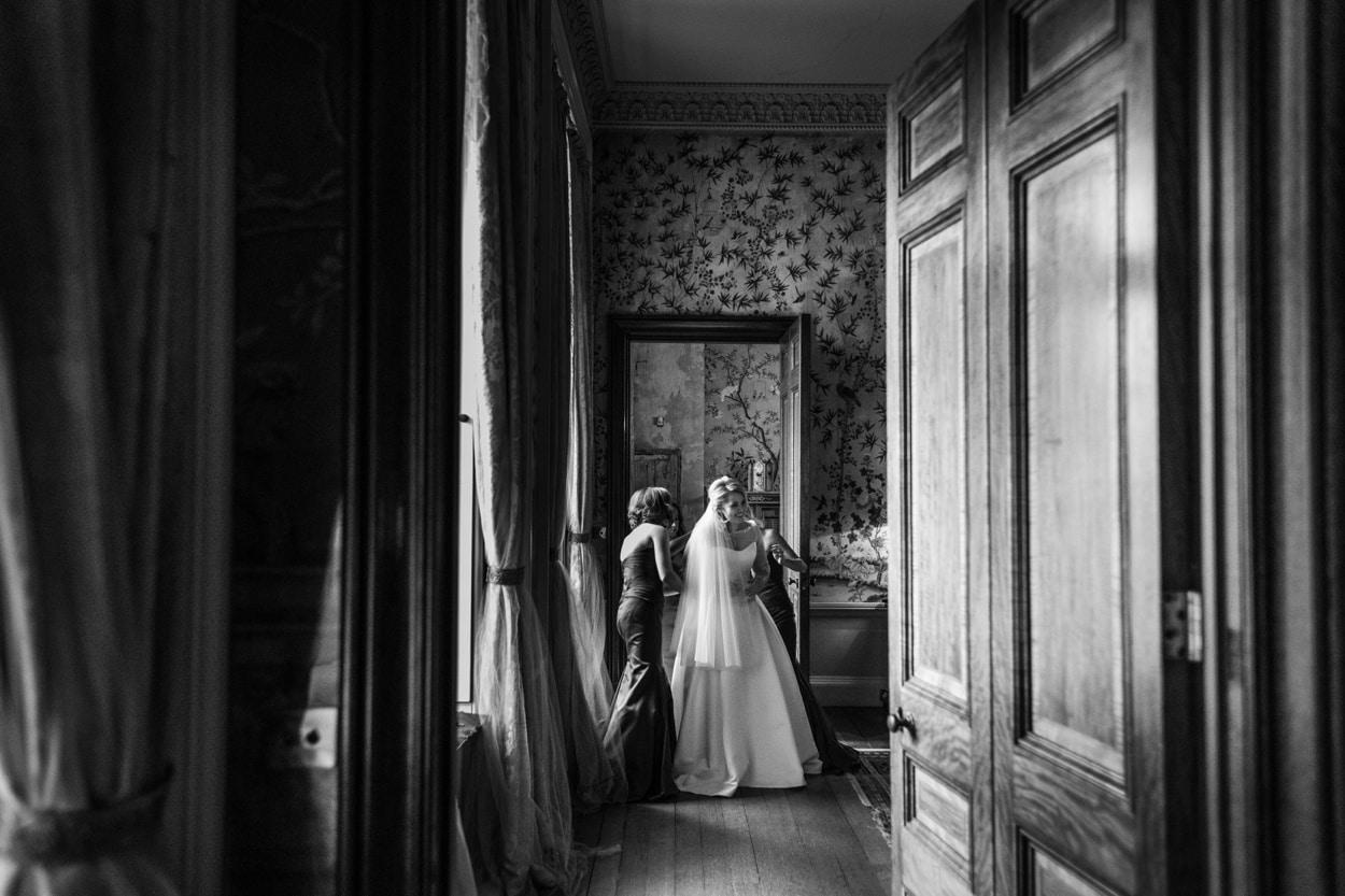 bride gets dressed in Kings Room at Belvoir Castle