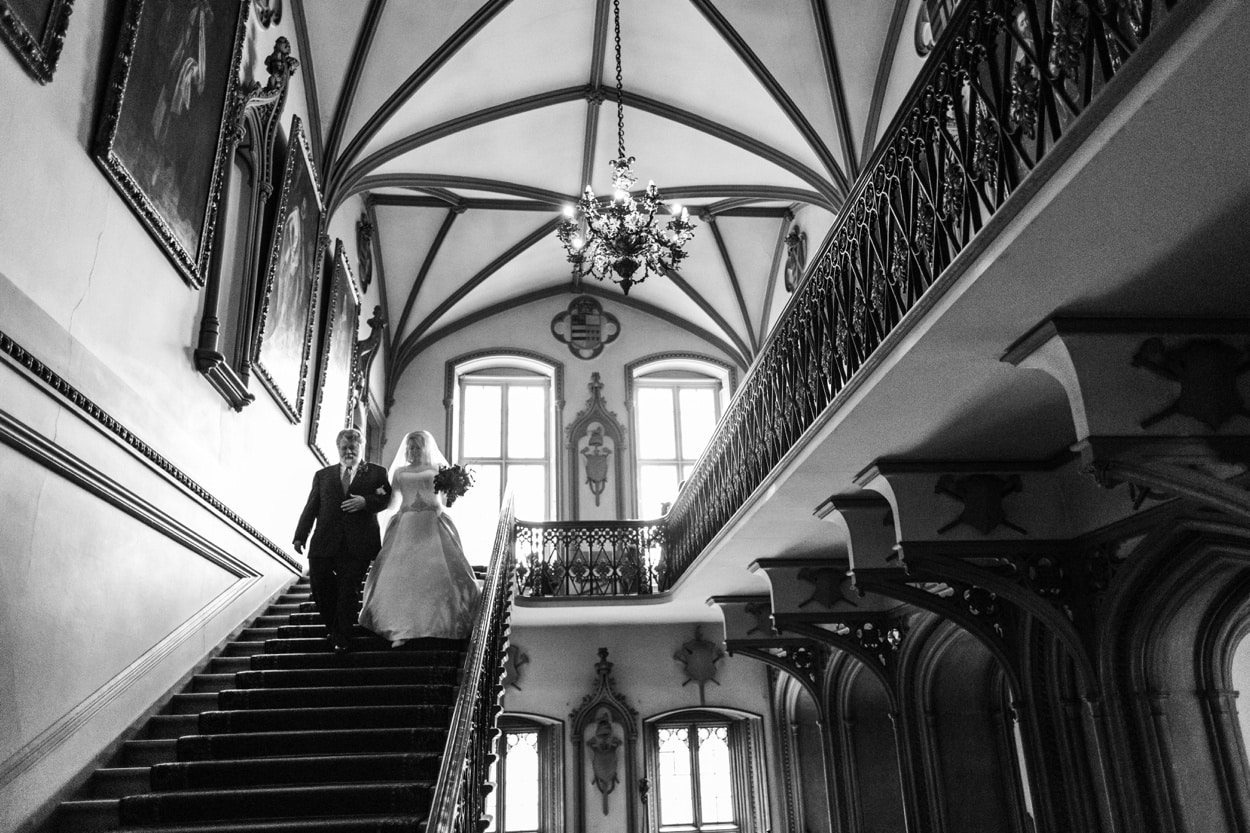 Bride and father descends Belvoir Castle stairs