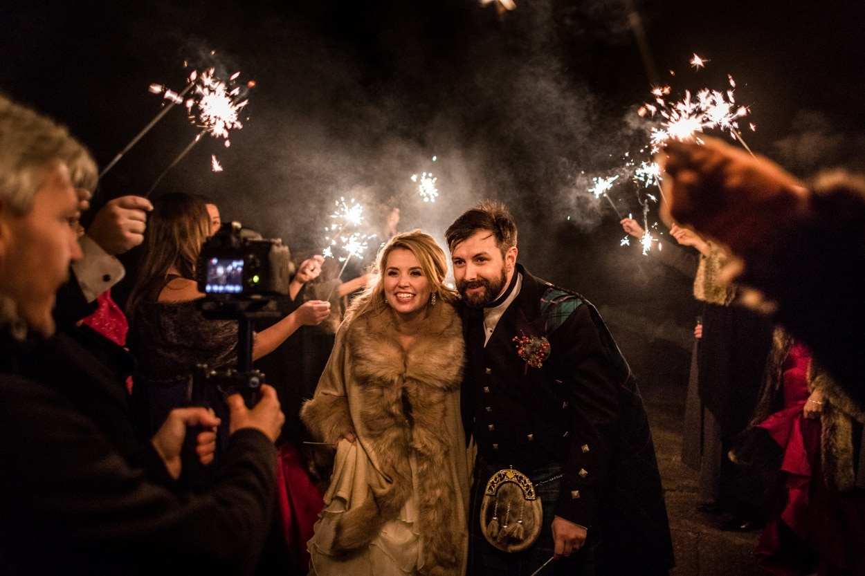 Bride and groom with sparklers at Belvoir Castle