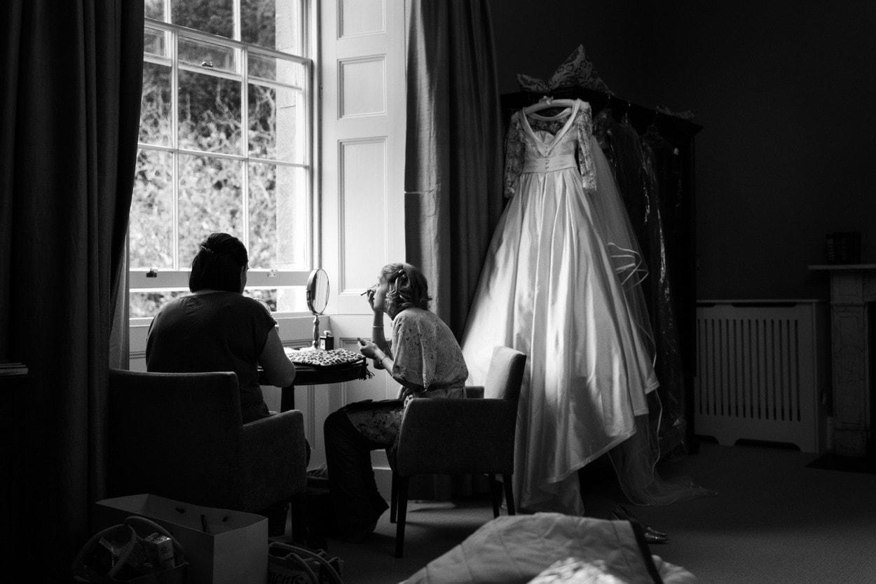Bride applying make up at Nanteos