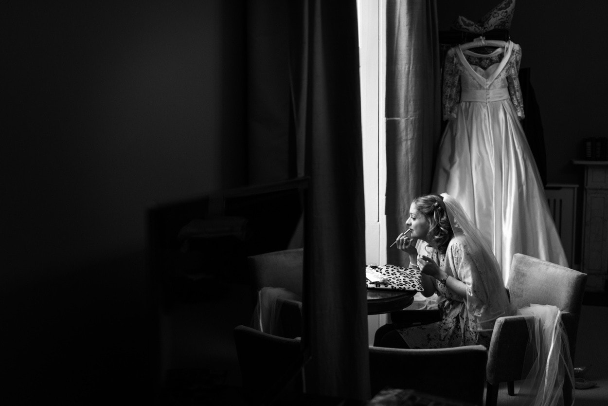 Bride applying make up at Nanteos