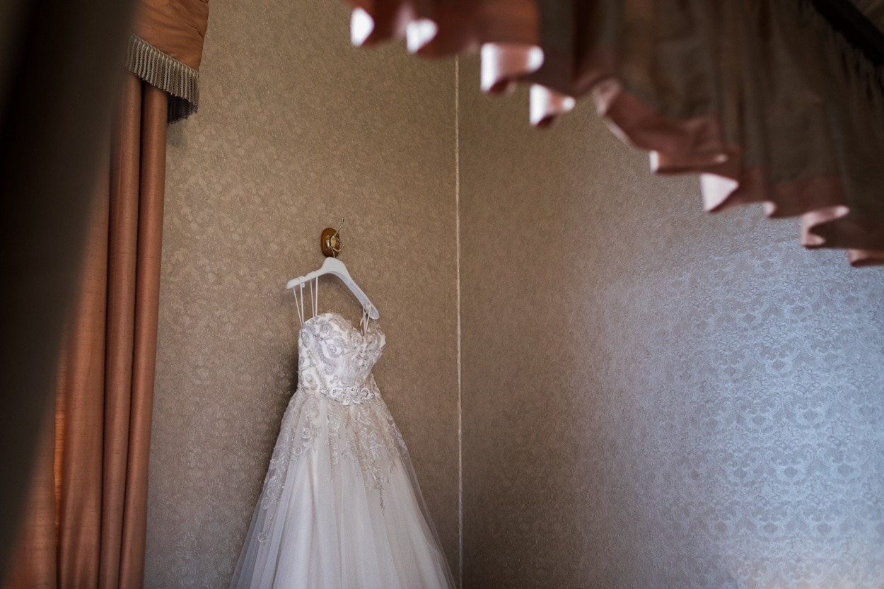 wedding dress hanging on wall at clearwell castle