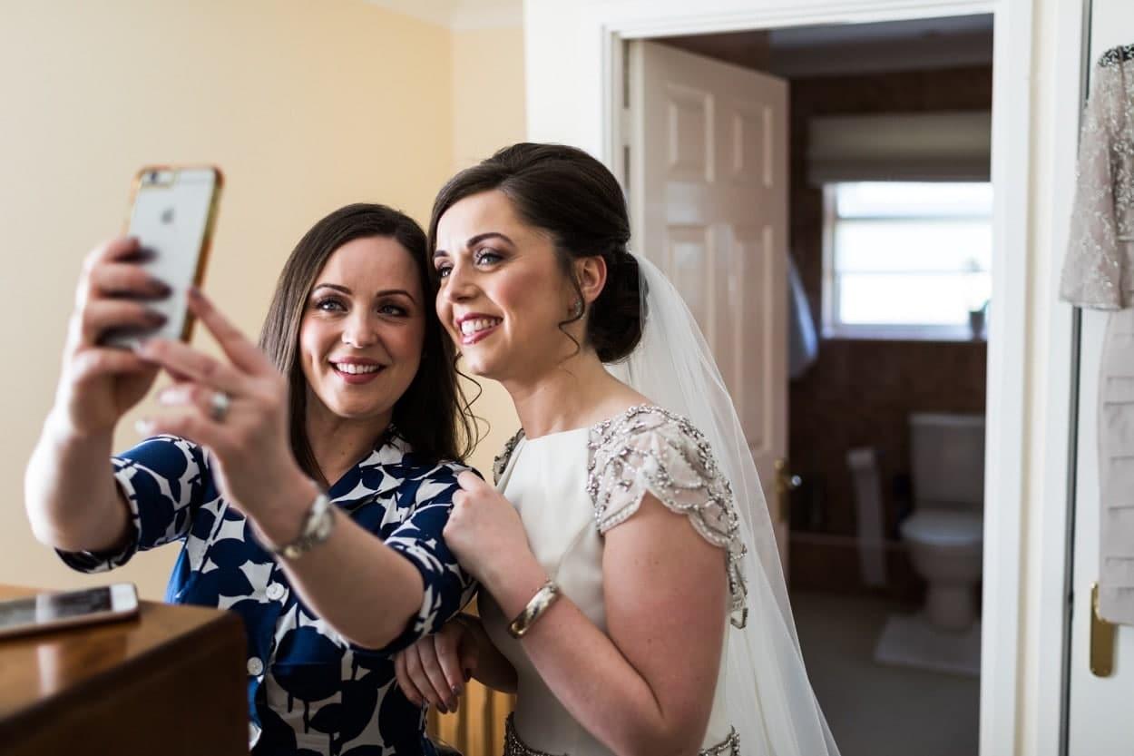 Bride and sister take selfie