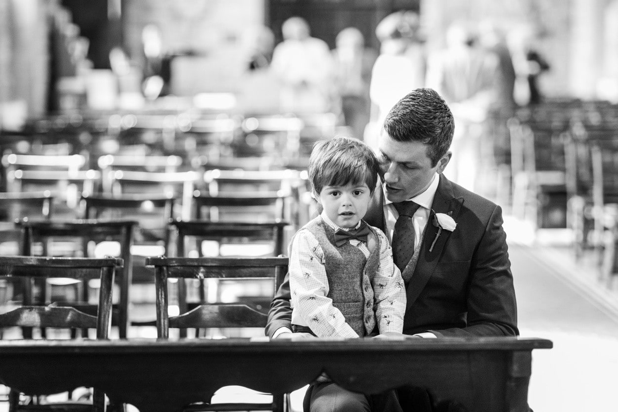 Groom and page boy wait for bride