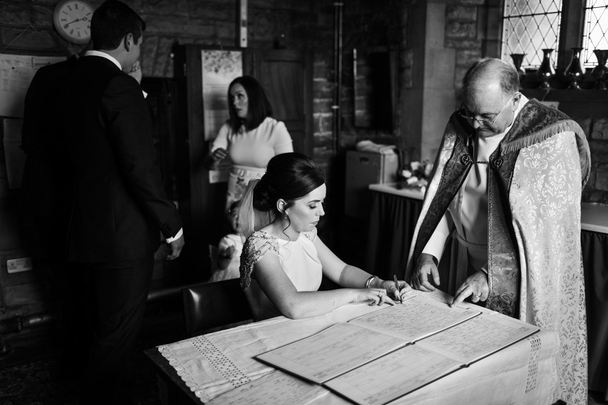 Bride signs wedding register in South Wales