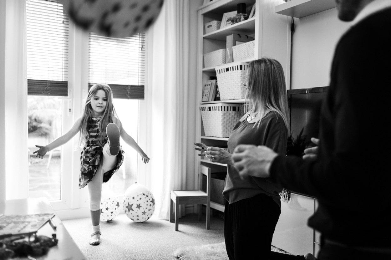 girl kicking ball