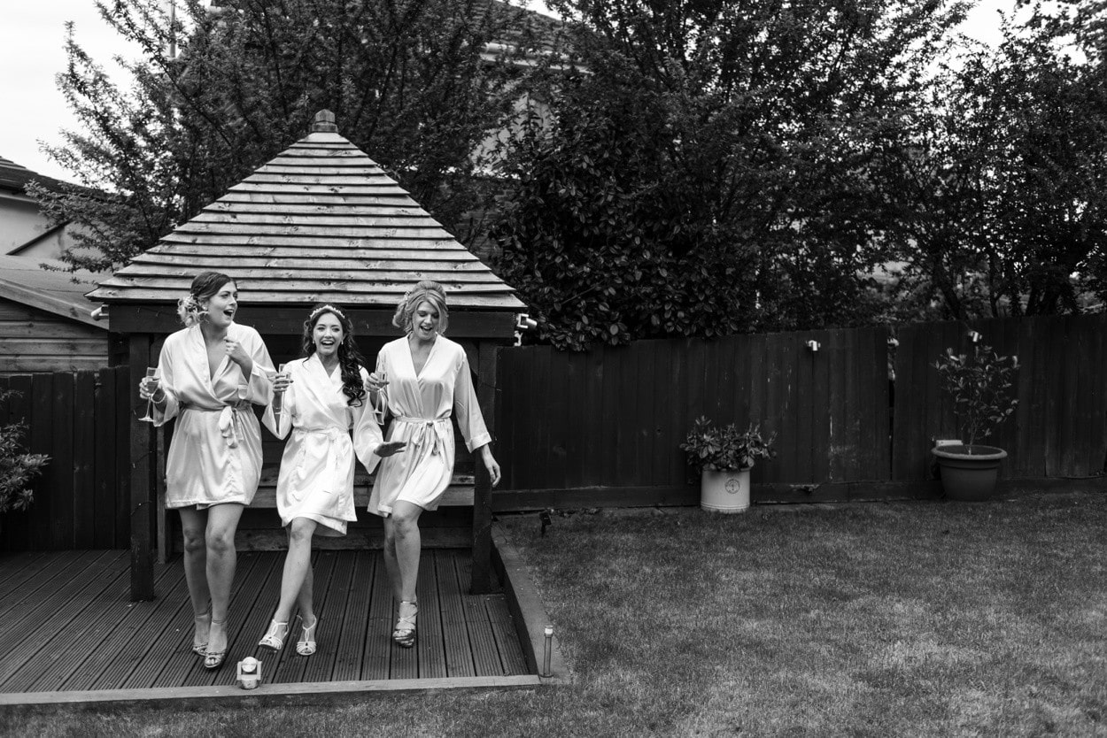 bride and bridesmaids dancing in garden