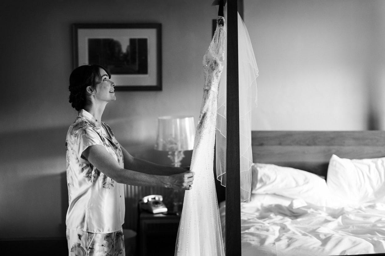 Bride looking at wedding dress at Hammet House
