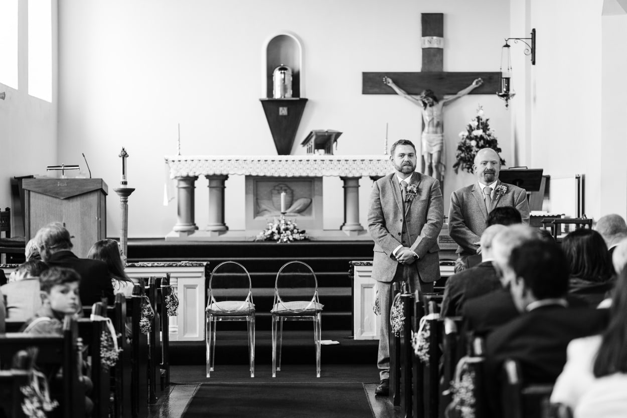 Groom waiting at Holy Name Church in Fishguard