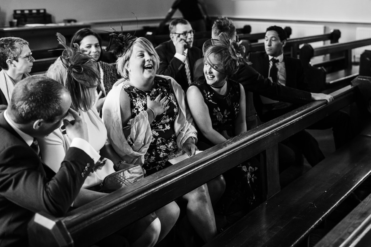 Friends laughing at Holy Name Church in Fishguard