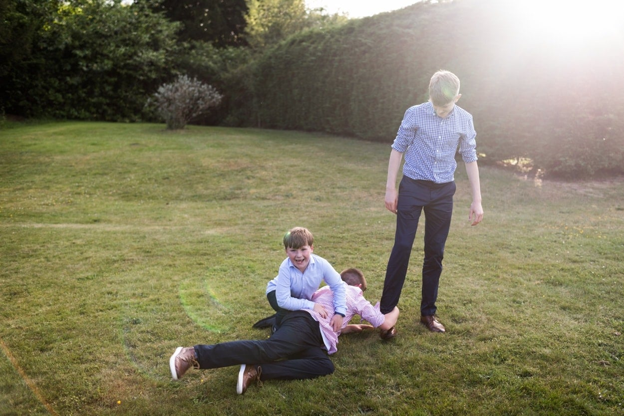 Boys playing on lawn at Hammet House
