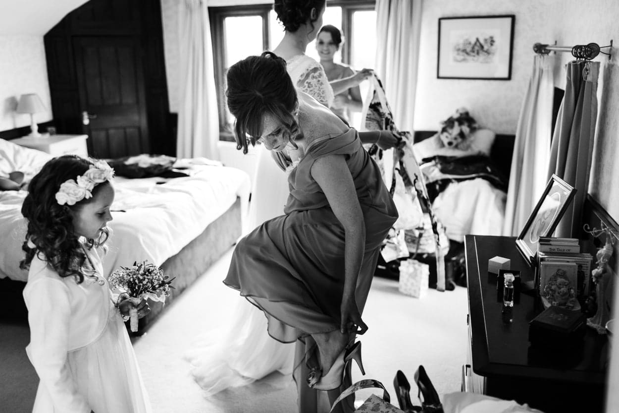 Bridesmaid putting on shoes