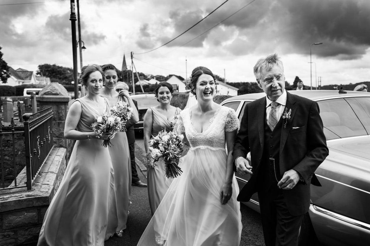 stormy clouds with bride and dad
