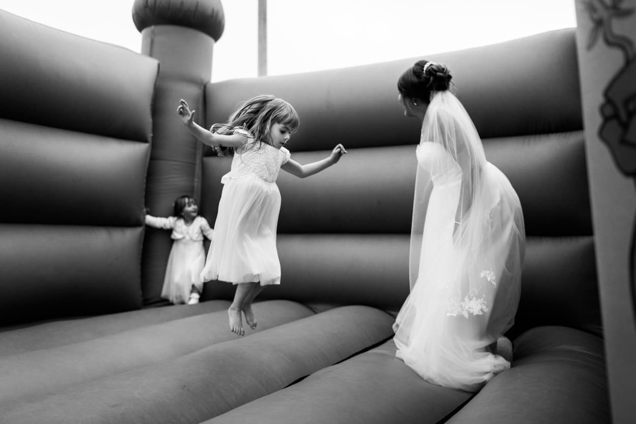 Bride on bouncy castle Woodhouse Barn Pembroekshire