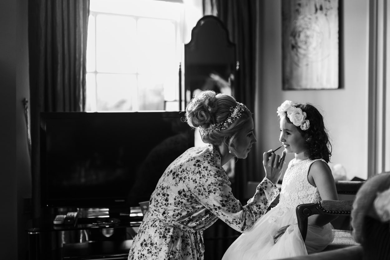 Bride does flower girls make up at Peterstone