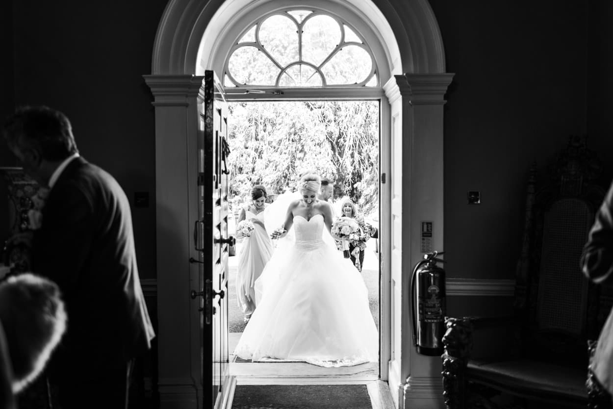 Bride walks through front door at Peterstone Court