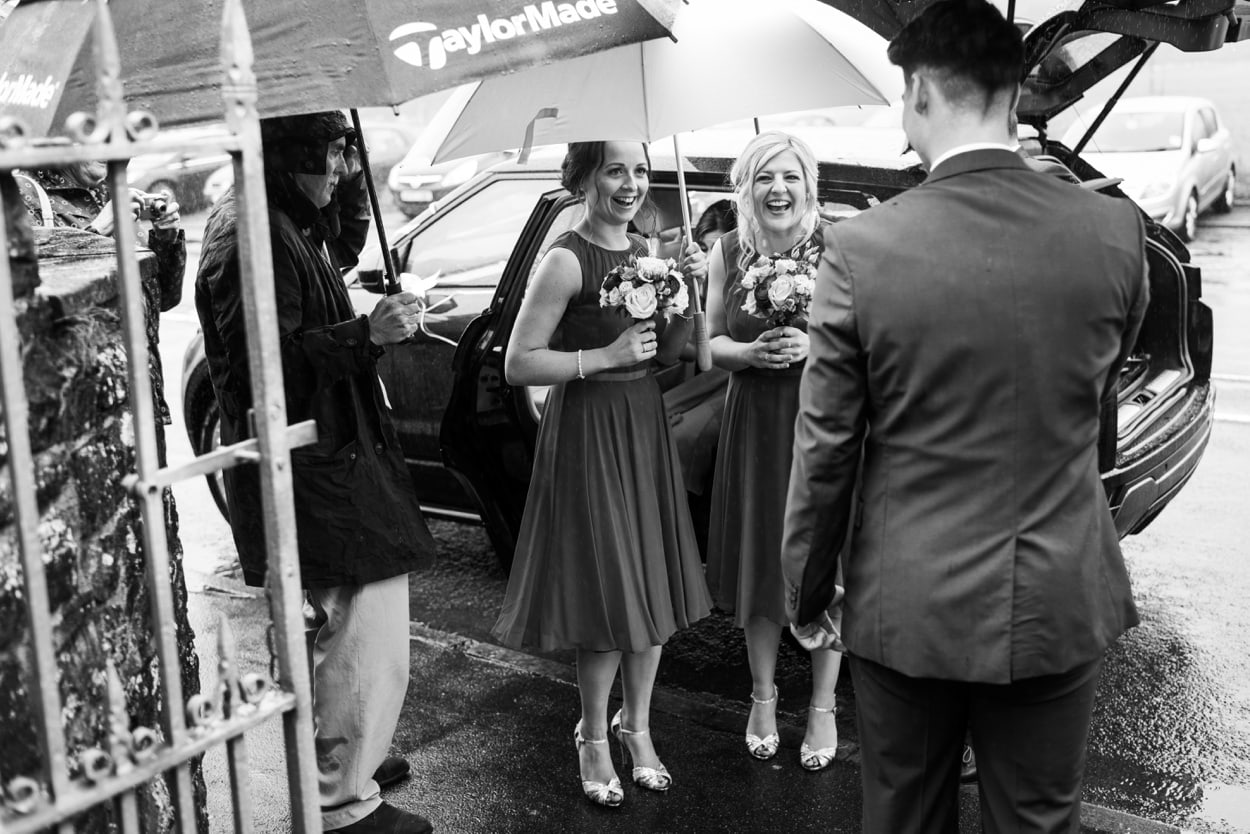 Bridesmaid in the rain at Capel Cana, Bancyfelin, West Wales