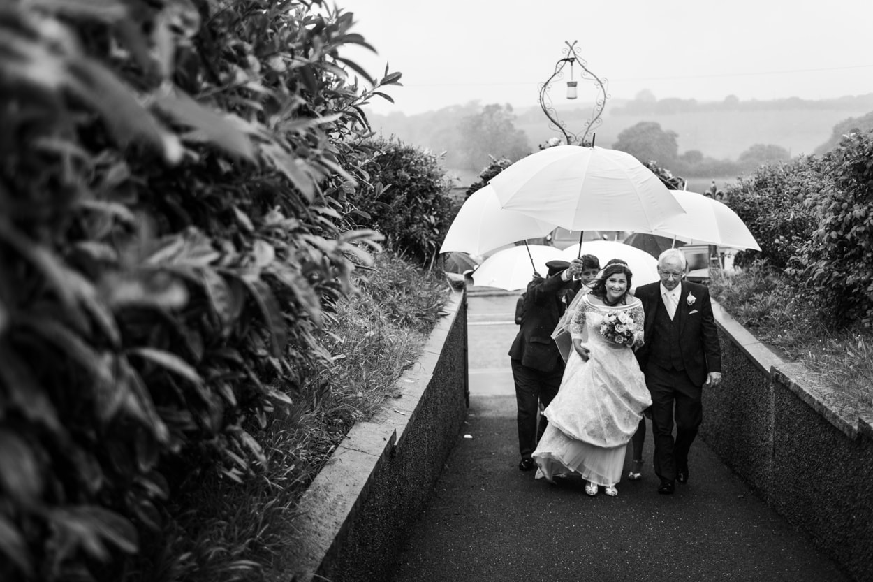 Bride arrives in the rain at Capel Cana, Bancyfelin, West Wales