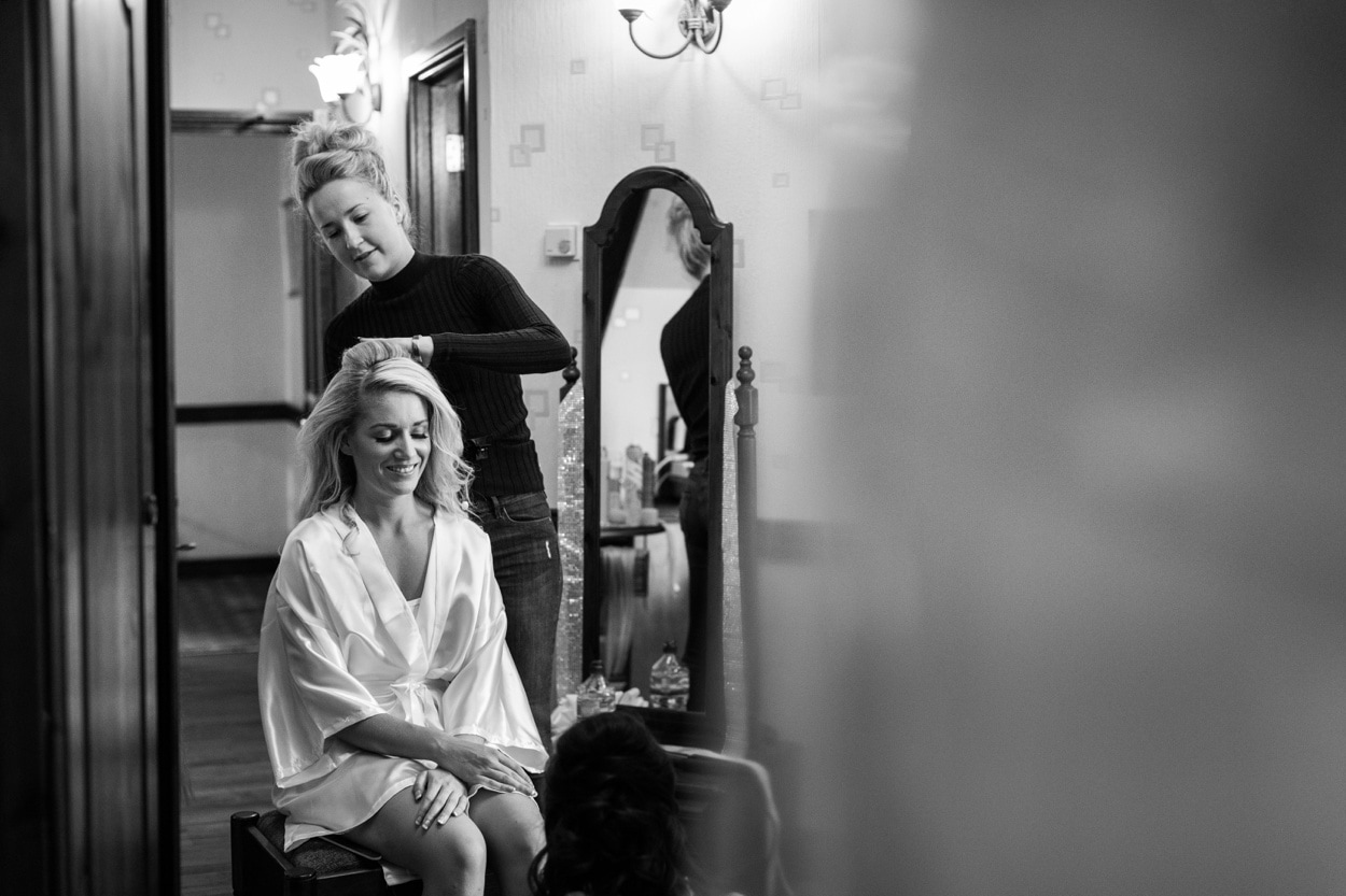Bride having hair done for Wedding at St Donats Castle