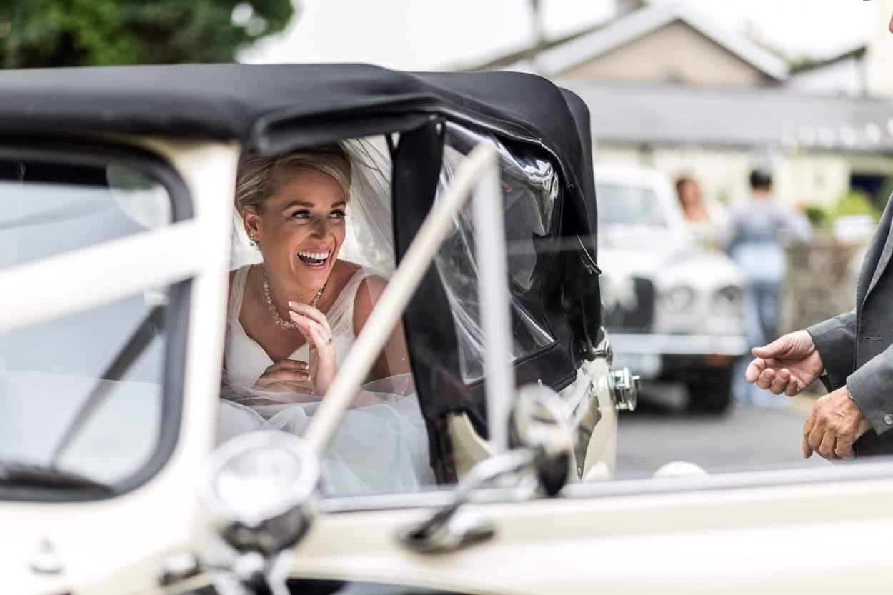 Bride arriving in car St Illtyds Church in Llantwit Major, South Wales