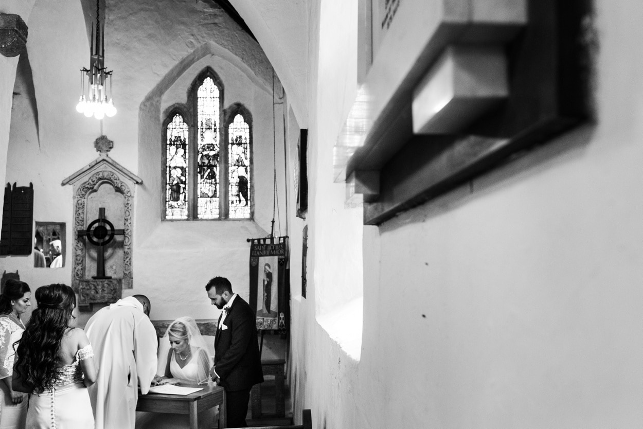 Signing of the register at St Illtyds Church in Llantwit Major, South Wales