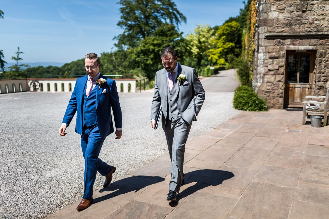 Groom arrives for summer wedding at Caer Llan