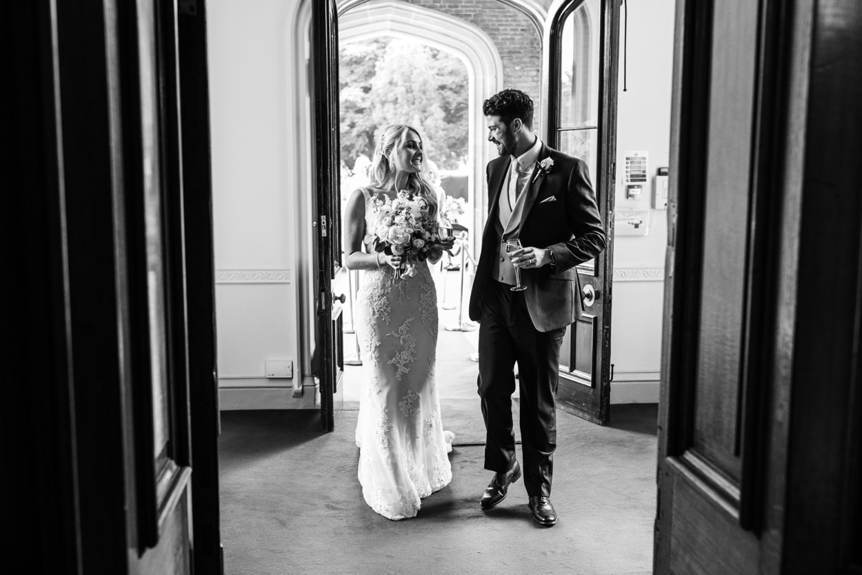 bride and groom arrive at Summertime wedding at Hensol Castle in South Wales