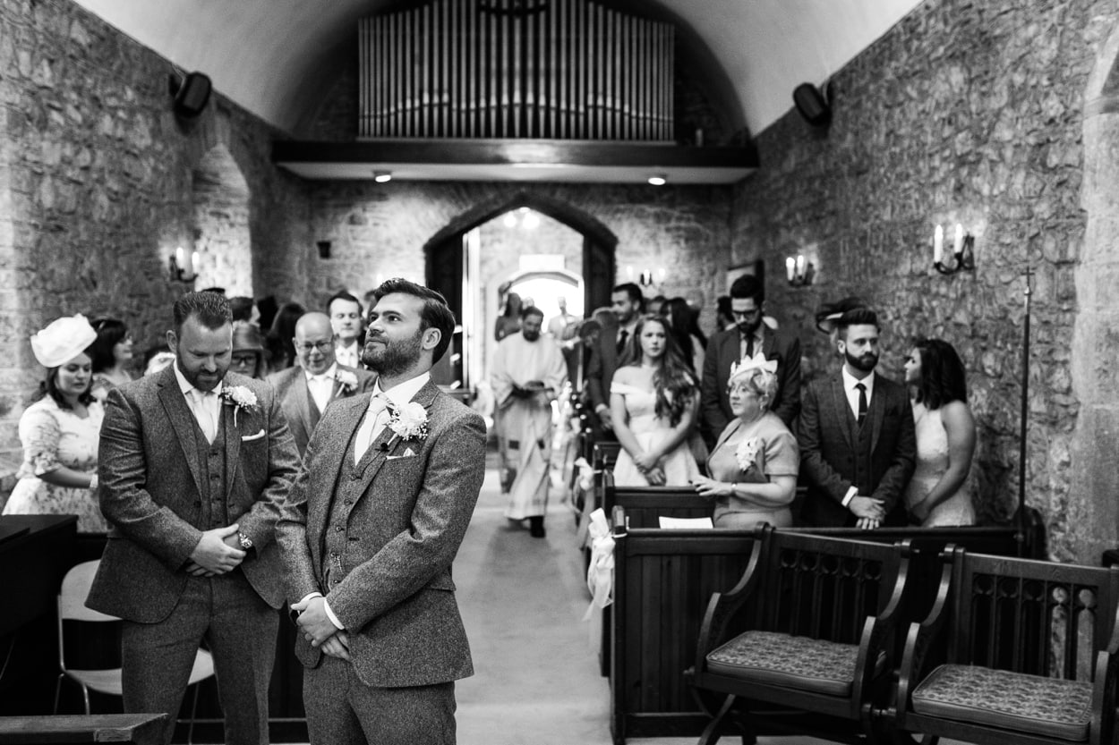 Groom waits at alter St Deny's Church in Lisvane, Cardiff