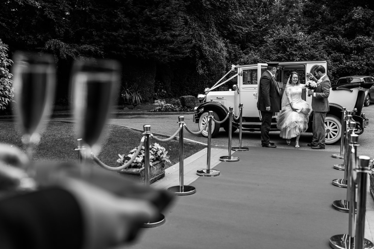 Bride and groom arrive De Courceys Manor near Cardiff in South Wales