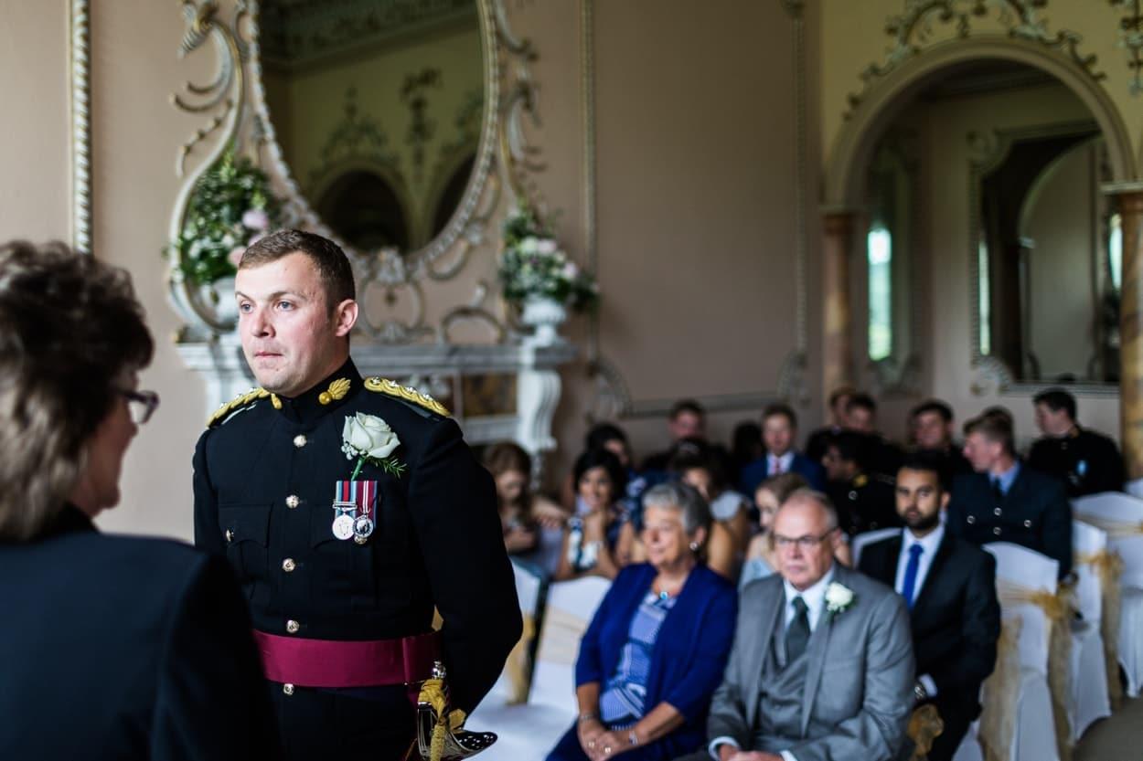 Army groom waits in Music Room at Nanteos