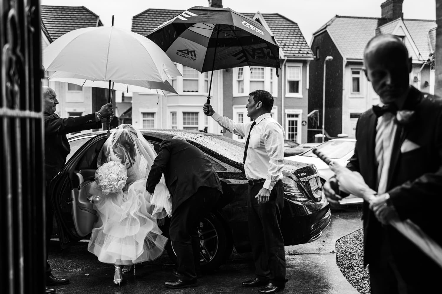 Bride arrives at church wedding in rain