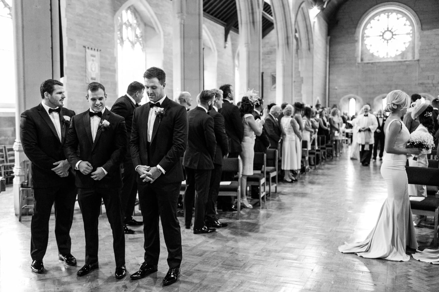 Groom waits at alter at All Saints Church , Porthcawl