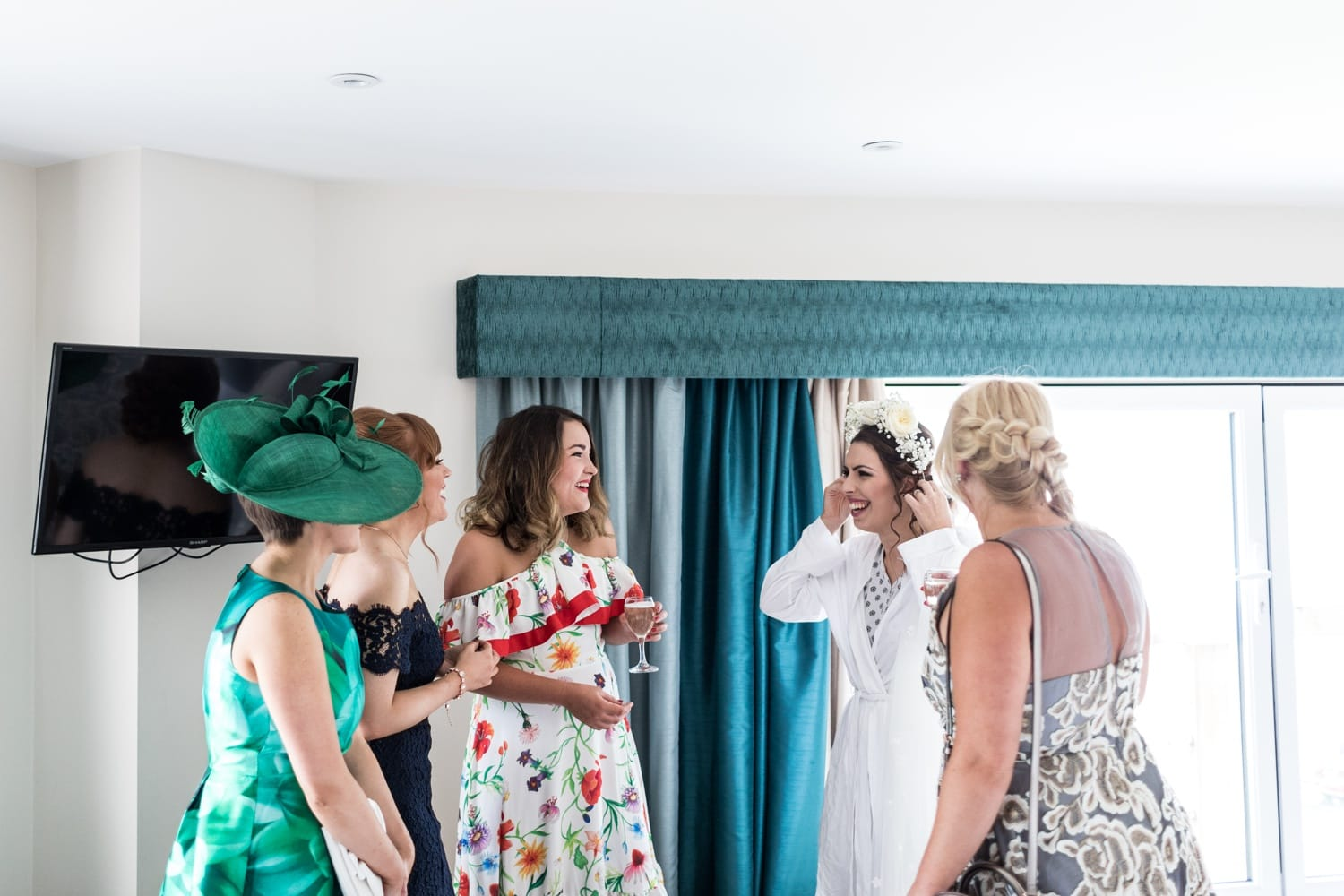 Bride shows friends her hair piece