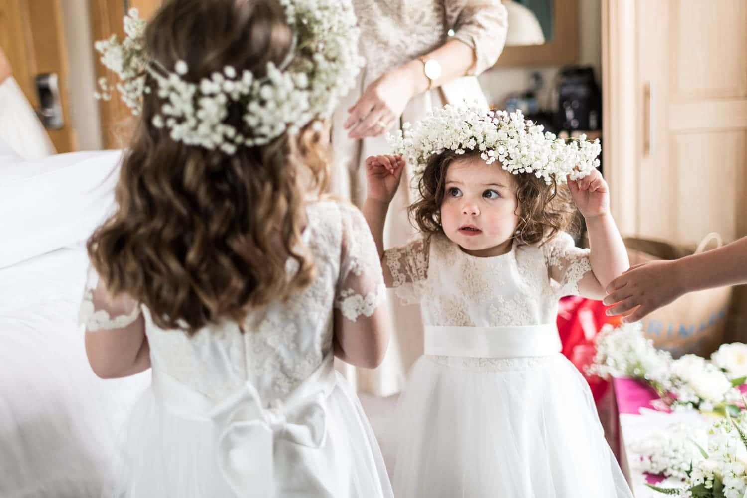 Flower girls adjusts hair crown